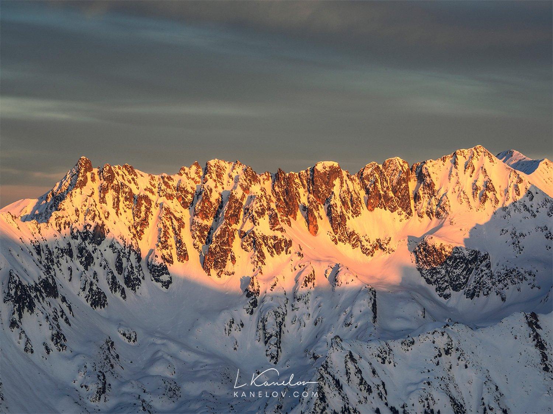 Snowy mountain peaks at sunset landscape