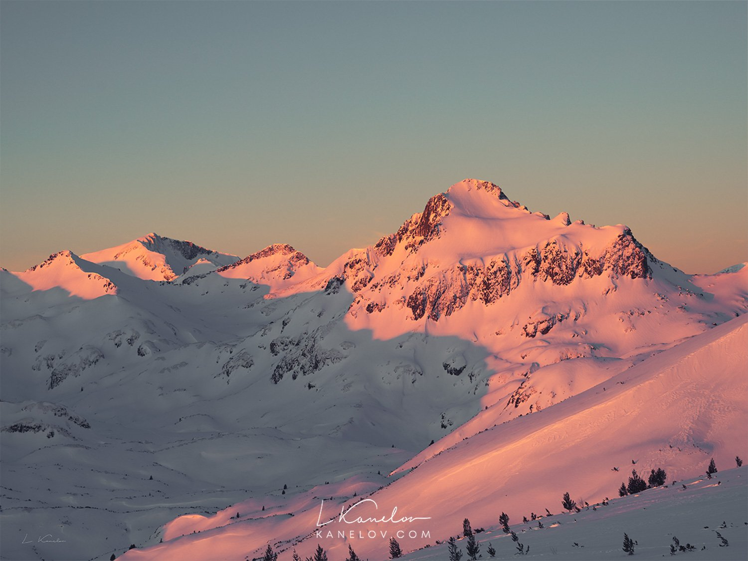 Winter sunset over a snow covered mountain